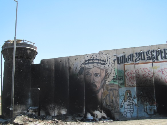 Graffiti and fire damage near the Qalandia checkpoint, West Bank, June 2014 ©James Rodgers