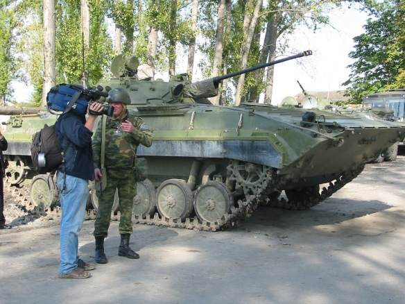 A cameraman talks to a Russian soldier, South Ossetia, October 2008. Photo © James Rodgers
